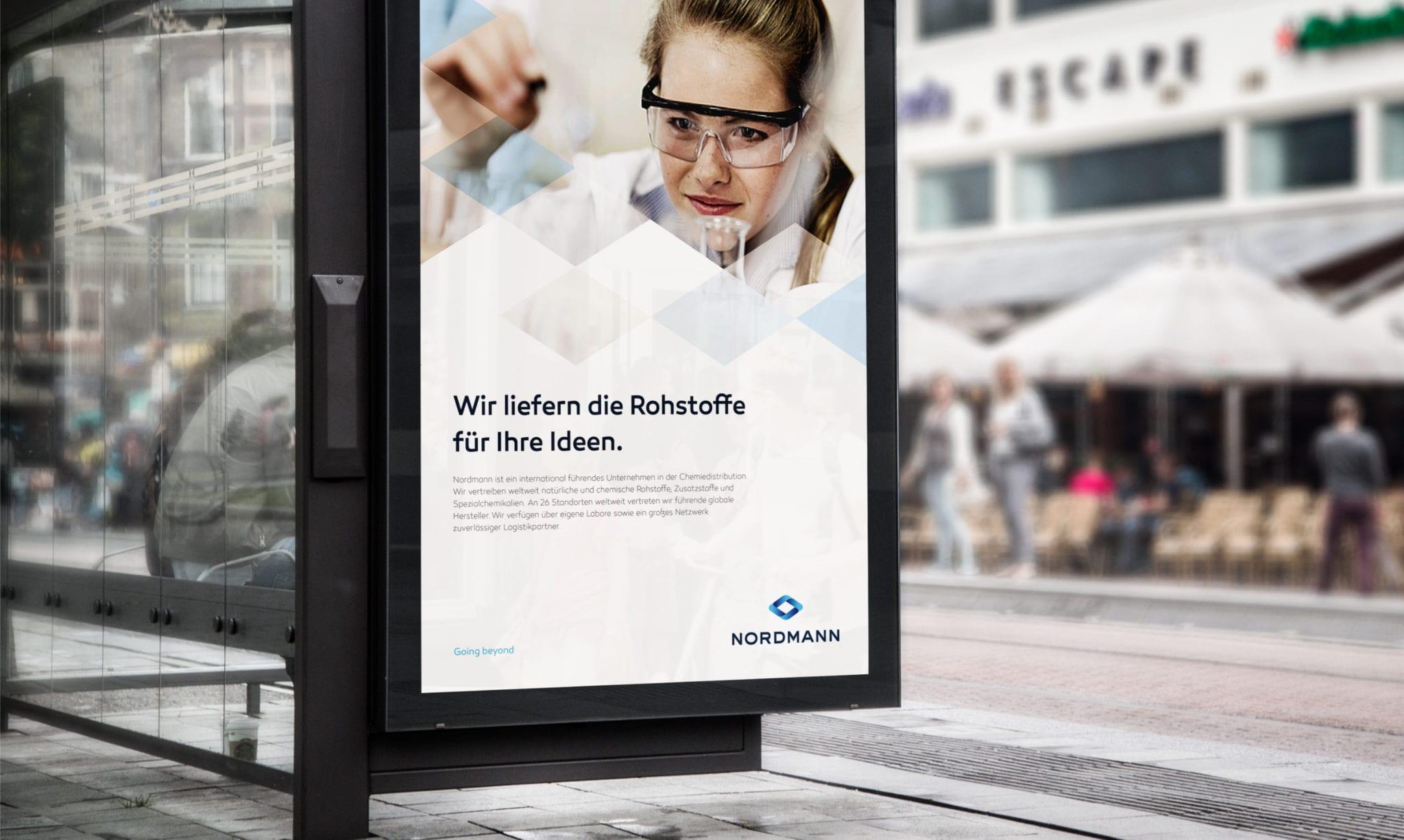 Nordmann poster at bus stop