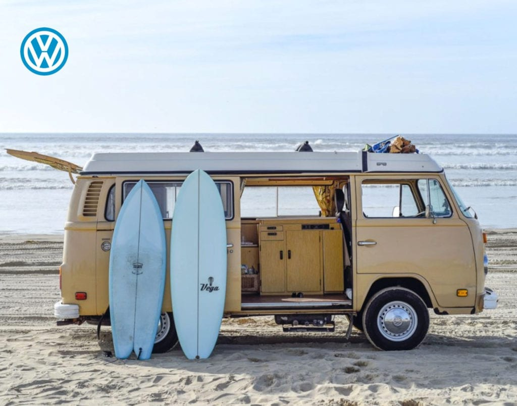 VW Bus and Surfboards at the Beach