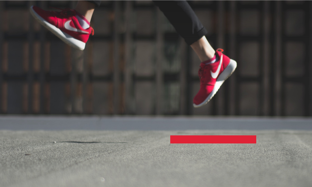 Red Nike shoes jumping - Photo by Banter Snaps on Unsplash