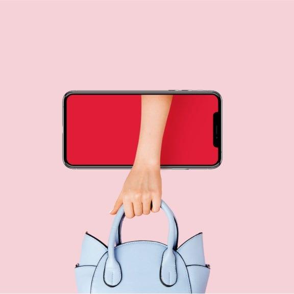 Smartphone und Handtasche
