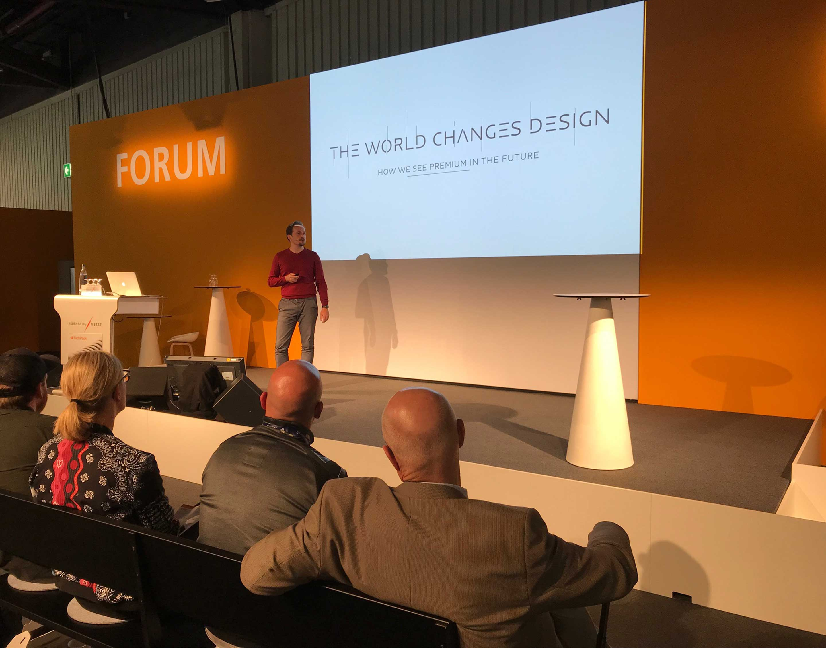 Daniel Graf on stage at FachPack 2019 presents his work on The World Changes Design